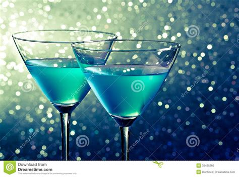 green cocktail black background two glasses of blue cocktail on dark green tint light
