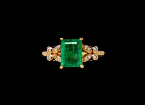6 80 Ct Emerald Certified 1 80 ct zambian emerald ring surrounded by 0 24 ct