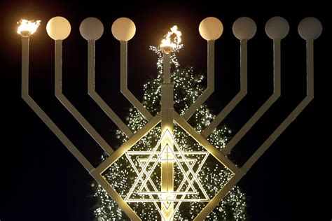 when does the festival of lights start menorahs light up around the for hanukkah 2014