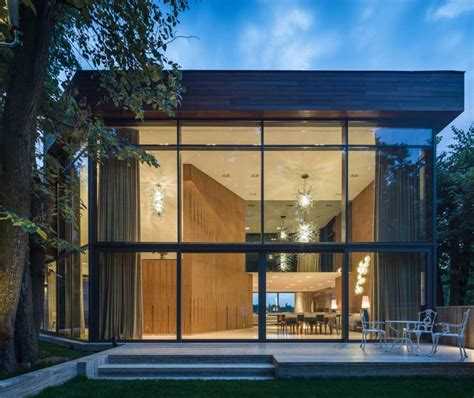 modern german house clad in glass offers unabated lake views extensive use of glass defining modern lake house in