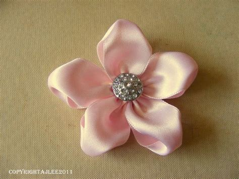 How To Make Flowers Out Of Paper Ribbon - 25 best ideas about ribbon flowers on fabric