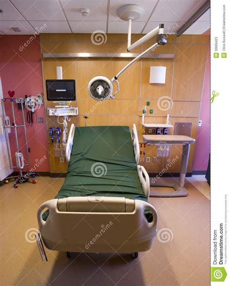 hospital recovery room bed examination light stock photos