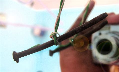 nail free hanging hanging nail photograph by tejender mohan