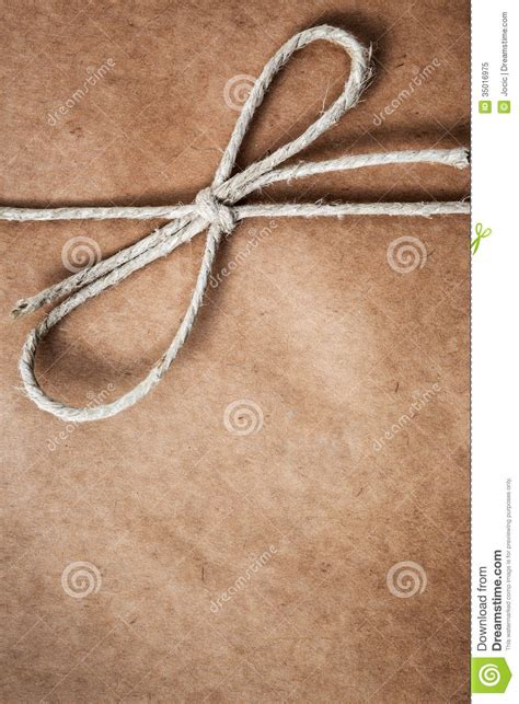 String On Paper - string in a bow brown package paper stock image