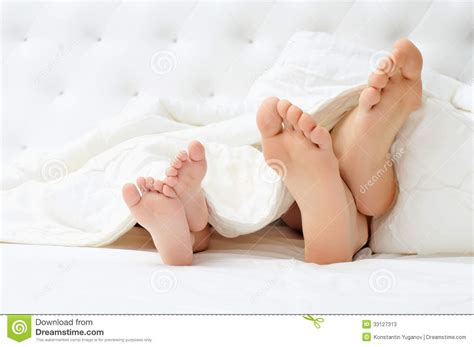 bed feet happy family stock photos image 33127313