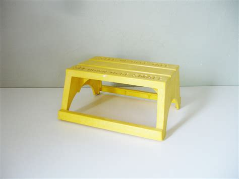 vintage yellow plastic step stool by empire toys