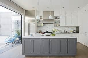 Kitchen that contrast with the stark white wall cabinets the gray
