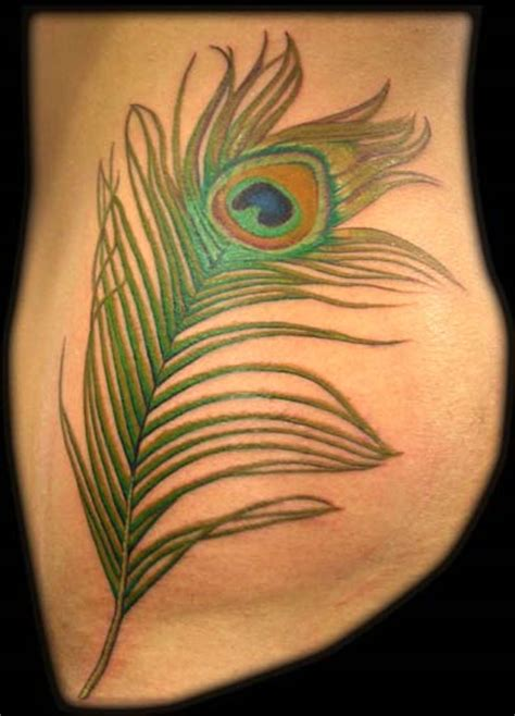 peacock feather tattoo hip peacock feather by aaron goolsby tattoos