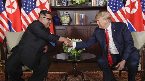 historic handshake  donald trump kim jong