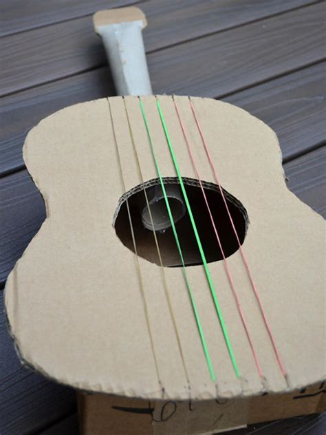 Make A Paper Guitar - turn cardboard boxes and paper towel rolls into toys diy