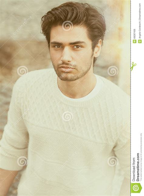 1970s men hairstyles look attractive and stylish handsome beautiful young man outdoor fashion hairstyle