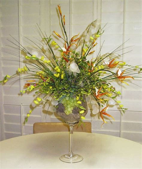 silk arrangement in large wine glass things i made