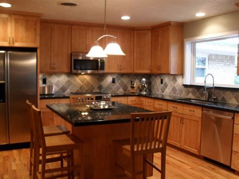 Granite Countertops With Black Appliances by Kitchen With Wood Floors Custom Cabinets Black Granite