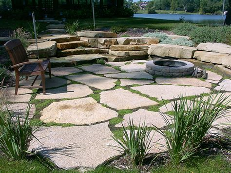 ideas for a backyard pit area i like the flagstone pavers w the grass peaking through