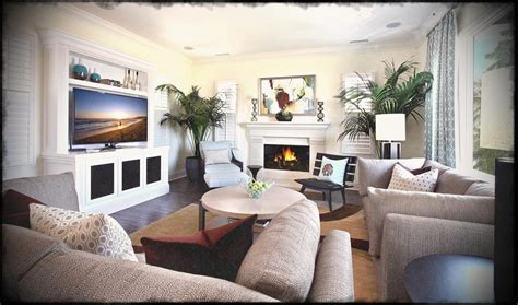 arranging furniture in living room with corner fireplace