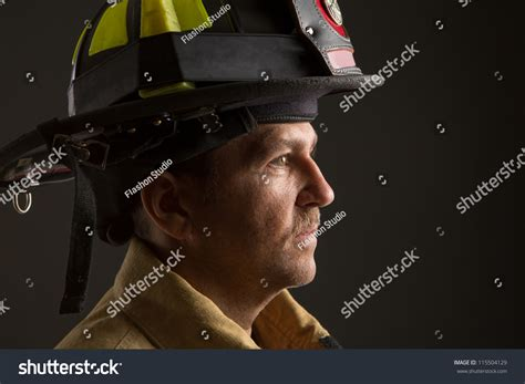serious looking confident firefighter headshot profile