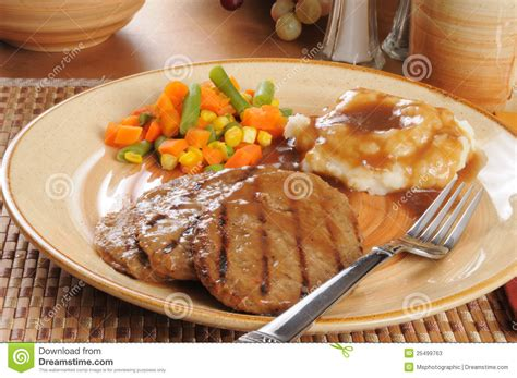 Hotplate Steak Potatoes salisbury steak dinner with mixed vegetables stock photos image 25499763