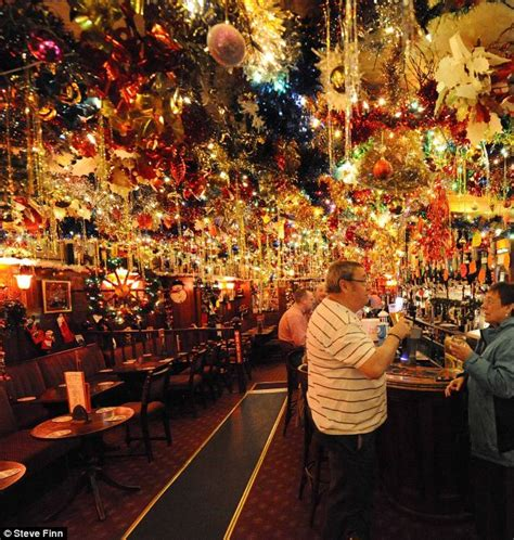 landlord illuminates his pub with 15 000 christmas lights