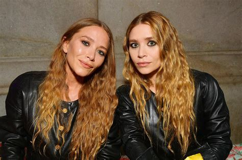 Mary Kate and Ashley Olsen wear matching leather outfits