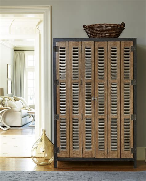 Universal Furniture Bar Cabinet Universal Moderne Muse Libations Locker With Tri Fold Doors Belfort Furniture Bar Cabinet