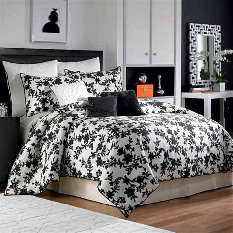 white bedspread and comforter with black flower and leaves