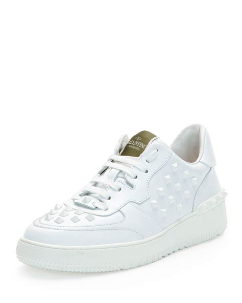 best white sneakers mens lyst valentino rock be studded low top sneakers in white