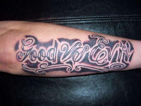 good vs evil tattoo sleeve vs evil on arm