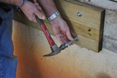 anchoring foamboard to concrete wall decks ledger board attachment to a solid concrete