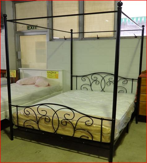 double canopy bed double bed four poster canopy bed available in white black or pink 299 qld bedding furniture