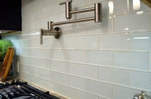 gloss kitchen tile ideas white gloss subway tiles with wall chrome swivel hanger stove top and marble countertops