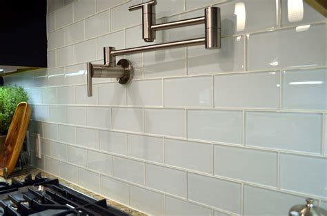 wall tiles for kitchen backsplash white gloss subway tiles with wall chrome swivel hanger stove top and marble countertops