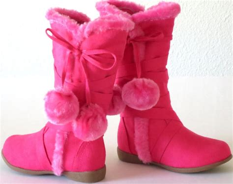 pink winter boots pink pom pom boots black suede boots brown