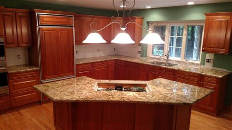 typhoon bordeaux granite  cherry red cabinets