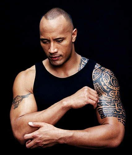 dwayne johnson getting tattoo dwayne johnson the rock body tattoo