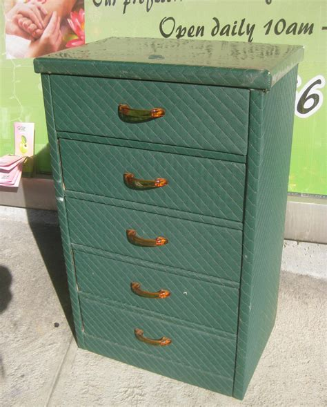 uhuru furniture collectibles sold green cardboard
