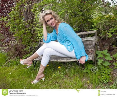 woman on bench beautiful woman on bench stock image image 33275341