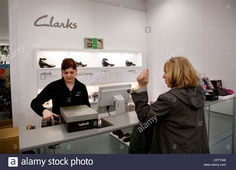 buying shoes a buying shoes at the checkout clarks shoe shop