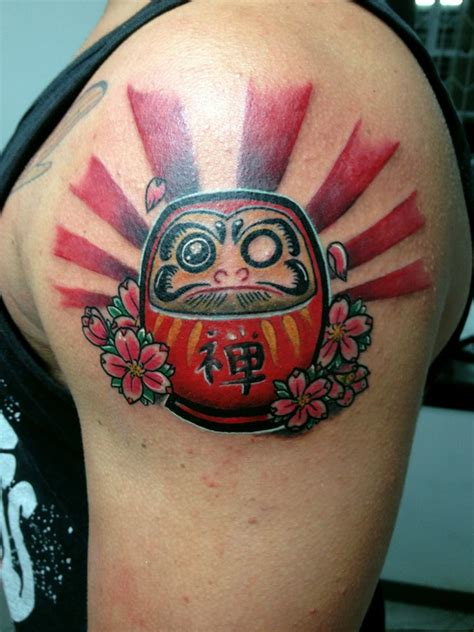daruma doll tattoo daruma doll on left shoulder by daniel rozo