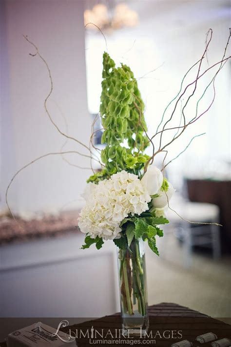 floral branches centerpiece tall green and white floral centerpiece with branches