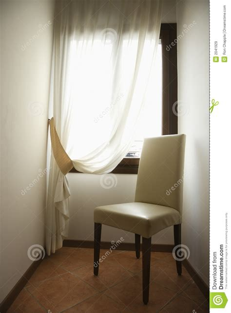 chair drapes empty chair by window with drapes royalty free stock