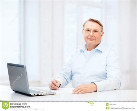 taxe bureau in eyeglasses filling a form at home stock photo
