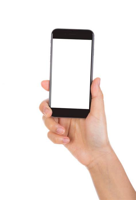 black mobile holding a black mobile photo free