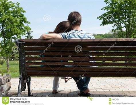 couple on park bench young couple on bench stock photography image 23842052