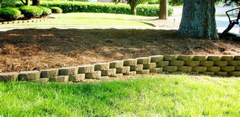 how to build retaining wall on sloped backyard how to build a stackable block retaining wall today s homeowner