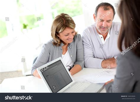 buy house reading senior couple ready to buy new house reading contract stock photo 104523029 shutterstock