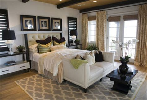 This romantic bedroom has loveseat table for two soft bedding and