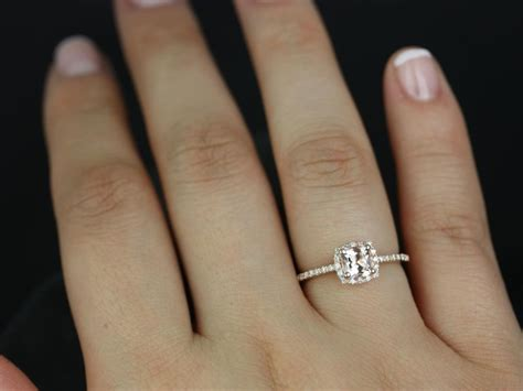 halo engagement ring on finger diamondstud
