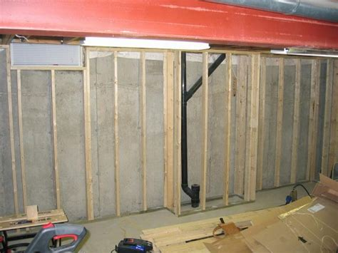 finishing basement remodel design with concrete wall