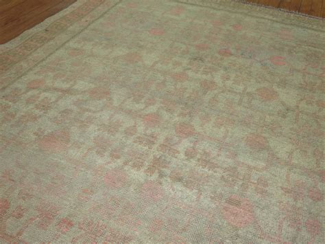 gray and pink east turkestan khotan rug at 1stdibs