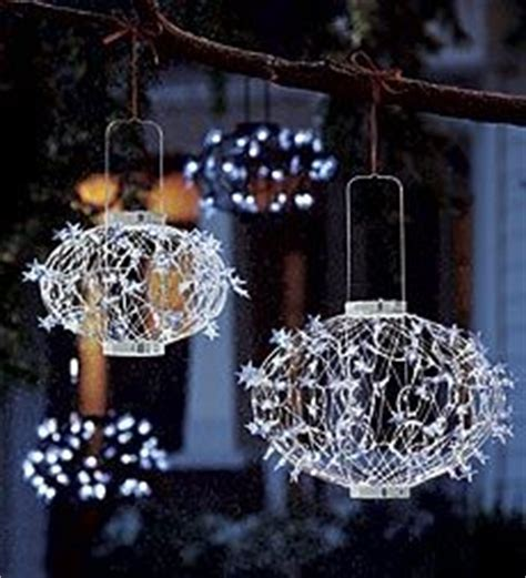 solar power hanging christmas balls pretty white solar lanterns look pristine in your winter versatile